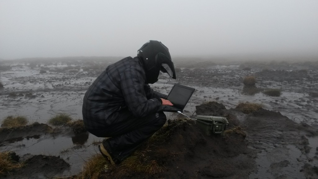 Arthur reprogramming a peat node. Not the best weather that day!